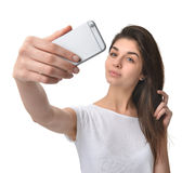 Young pretty woman make self portrait selfie with her cellphone Stock Photo