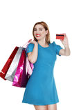 Young pretty woman makes shopping with credit card Stock Images