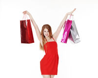 Young pretty woman makes shopping Royalty Free Stock Photography