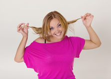 Young pretty woman making funny faces Stock Photo