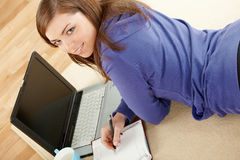 Young pretty woman making notes Stock Photography