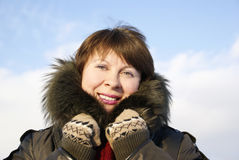 Young pretty woman muffles up in a fur collar Royalty Free Stock Images