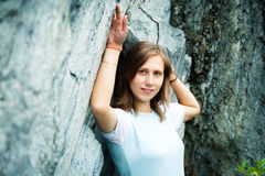 Young pretty woman next to granite rock Royalty Free Stock Photo