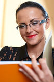 Young pretty woman with orange book in hands Stock Photography
