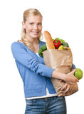 Young pretty woman with a paper bag Royalty Free Stock Photo