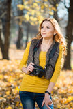 Young pretty woman in the park with photocamera Royalty Free Stock Images