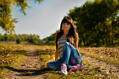 Young pretty woman in park royalty free stock images