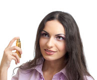 Young pretty woman with perfume isolated Stock Image