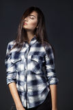 Young pretty woman in plaid shirt. Young pretty woman in shirt Royalty Free Stock Images