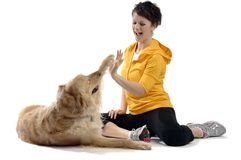 Young pretty woman plays with her dog. Golden retriever stock images