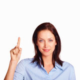 Young pretty woman pointing up at copy space Stock Photography