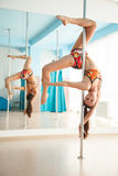 Young pretty woman  pole dancing Stock Image
