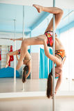 Young pretty woman  pole dancing Stock Photography