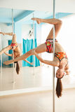 Young pretty woman  pole dancing Stock Images