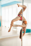 Young pretty woman  pole dancing Royalty Free Stock Photos
