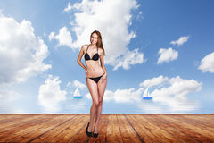 Young pretty woman posing on the pier. Stock Images