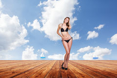 Young pretty woman posing on the pier. Royalty Free Stock Photography