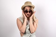 Young pretty woman posing for a portrait with a surprised excite Royalty Free Stock Photos