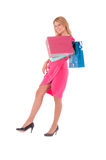 Young pretty woman posing with  shopping bags Stock Images