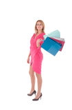 Young pretty woman posing with  shopping bags Royalty Free Stock Images