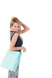Young pretty woman posing with  shopping bags Royalty Free Stock Photography