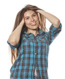 Young pretty woman posing on white background isolated emotional hipster student thinking smiling Stock Photography