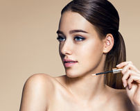 Young pretty woman with professional make-up Stock Photos