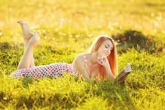 Young pretty woman reading book. Stock Photos