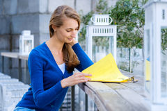 Young pretty woman reading menu Royalty Free Stock Images