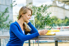 Young pretty woman reading menu Stock Photography