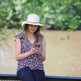 Young and pretty woman reading a message on her smartphone stock photos