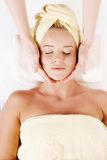 Young pretty woman receiving face massage Stock Photo
