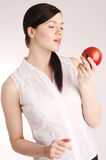 Young pretty woman with red apple Royalty Free Stock Image