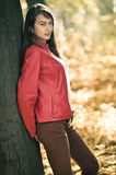 Young pretty woman in red jacket Royalty Free Stock Image