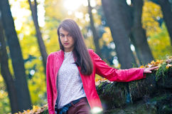 Young pretty woman in red jacket Royalty Free Stock Photos