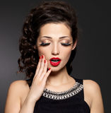 Young pretty woman with red manicure and  lips Royalty Free Stock Images