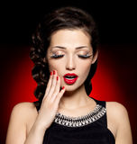 Young pretty woman with red manicure and  lips Royalty Free Stock Photography