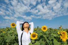 Young pretty woman relaxation. Young adult  woman relaxation on  sunflowers field Stock Photos