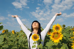 Young pretty woman relaxation. Young adult  woman relaxation on  sunflowers field Royalty Free Stock Image