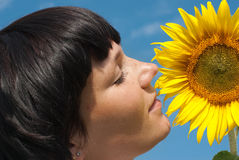 Young pretty woman relaxation. Young adult  woman relaxation on  sunflowers field Stock Photography