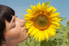 Young pretty woman relaxation. Young adult  woman relaxation on  sunflowers field Stock Image