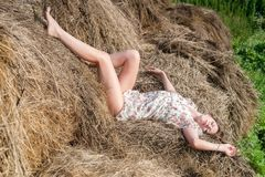 Young pretty woman relaxes on hay Royalty Free Stock Image
