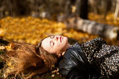 Young pretty woman relaxing in the autumn park stock images