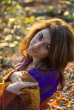 Young pretty woman relaxing in the autumn park Royalty Free Stock Photography