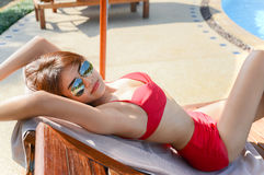 Young pretty woman relaxing on sunbed Royalty Free Stock Photo