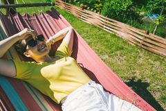 Young pretty woman rest in hammock Stock Photos