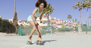 Young pretty woman riding in roller skates Stock Photos