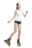 Young pretty woman on roller skates Stock Image