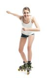Young pretty woman on roller skates Stock Photography
