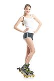 Young pretty woman on roller skates Royalty Free Stock Photo